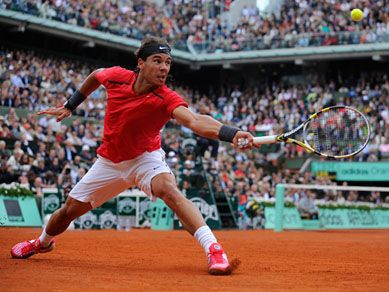 Rafa Nadal The Clay Maestro Swinging For The Tennis Ball At Roland Garros French Open Roland Garros Rafael Nadal Tennis Clothes
