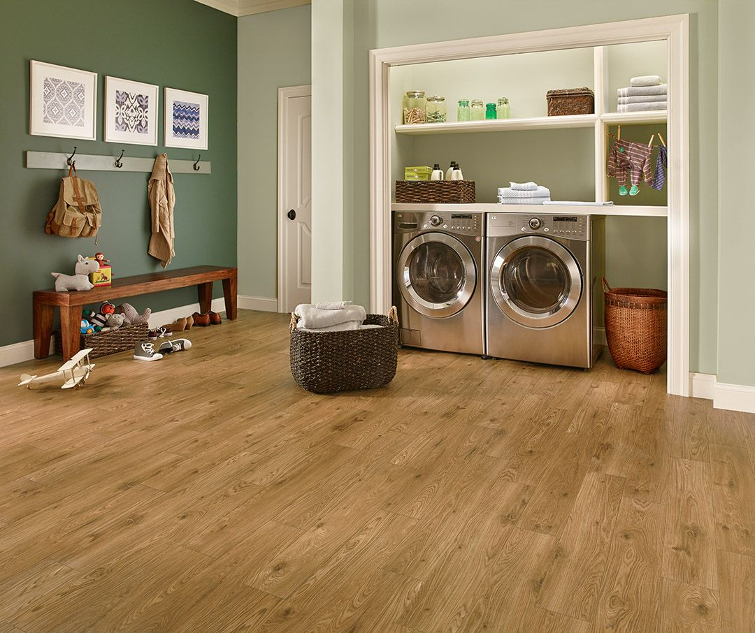The water resistance of lvp makes it a great flooring for Laundry room floor ideas