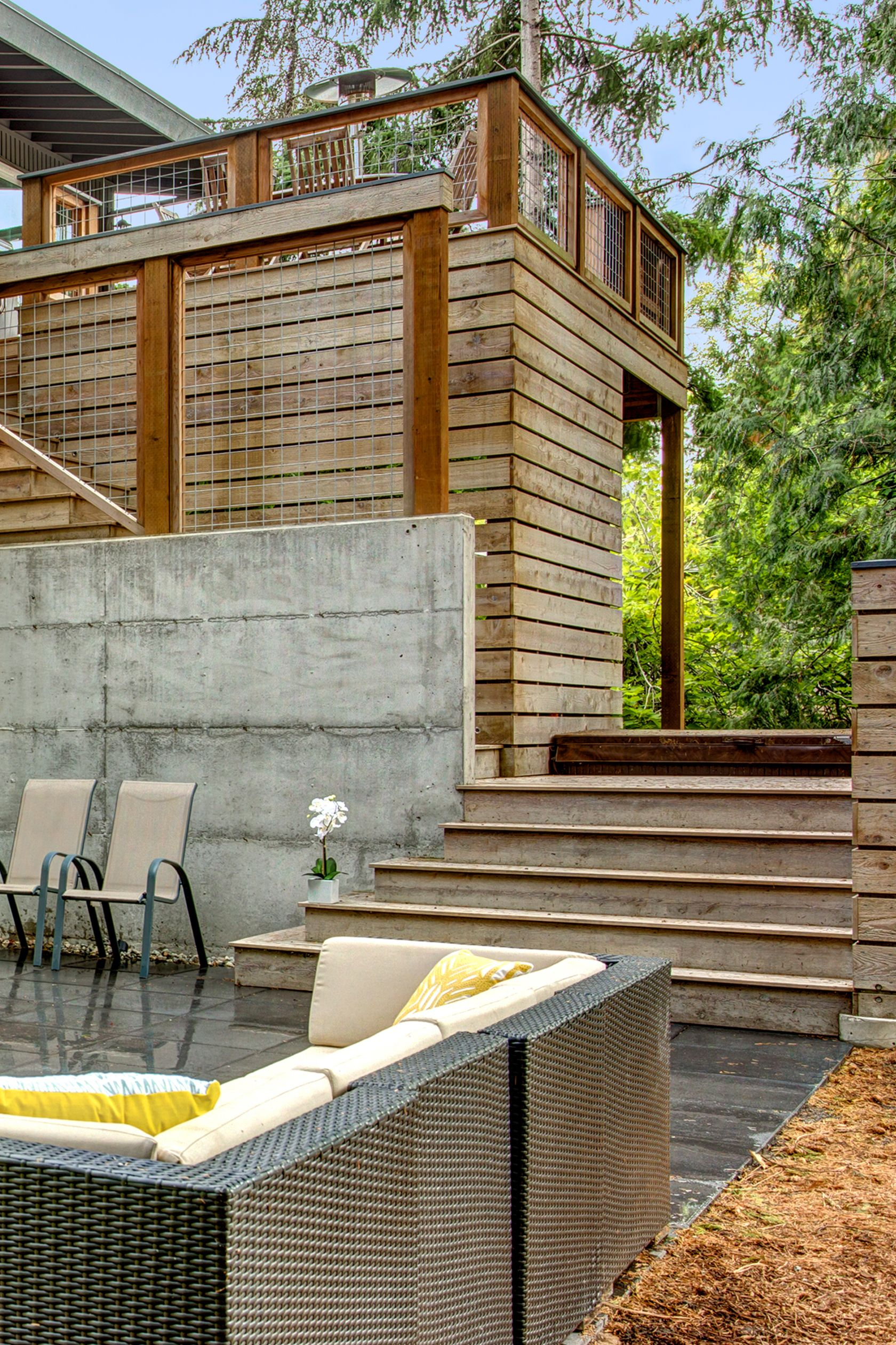 Modern Split: Split Level Remodel U2013 Wood Slat Detailing At Deck And Patio.
