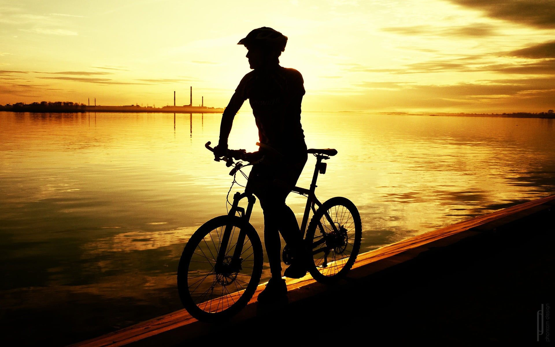 silhouette of man riding bike sunlight sport bicycle