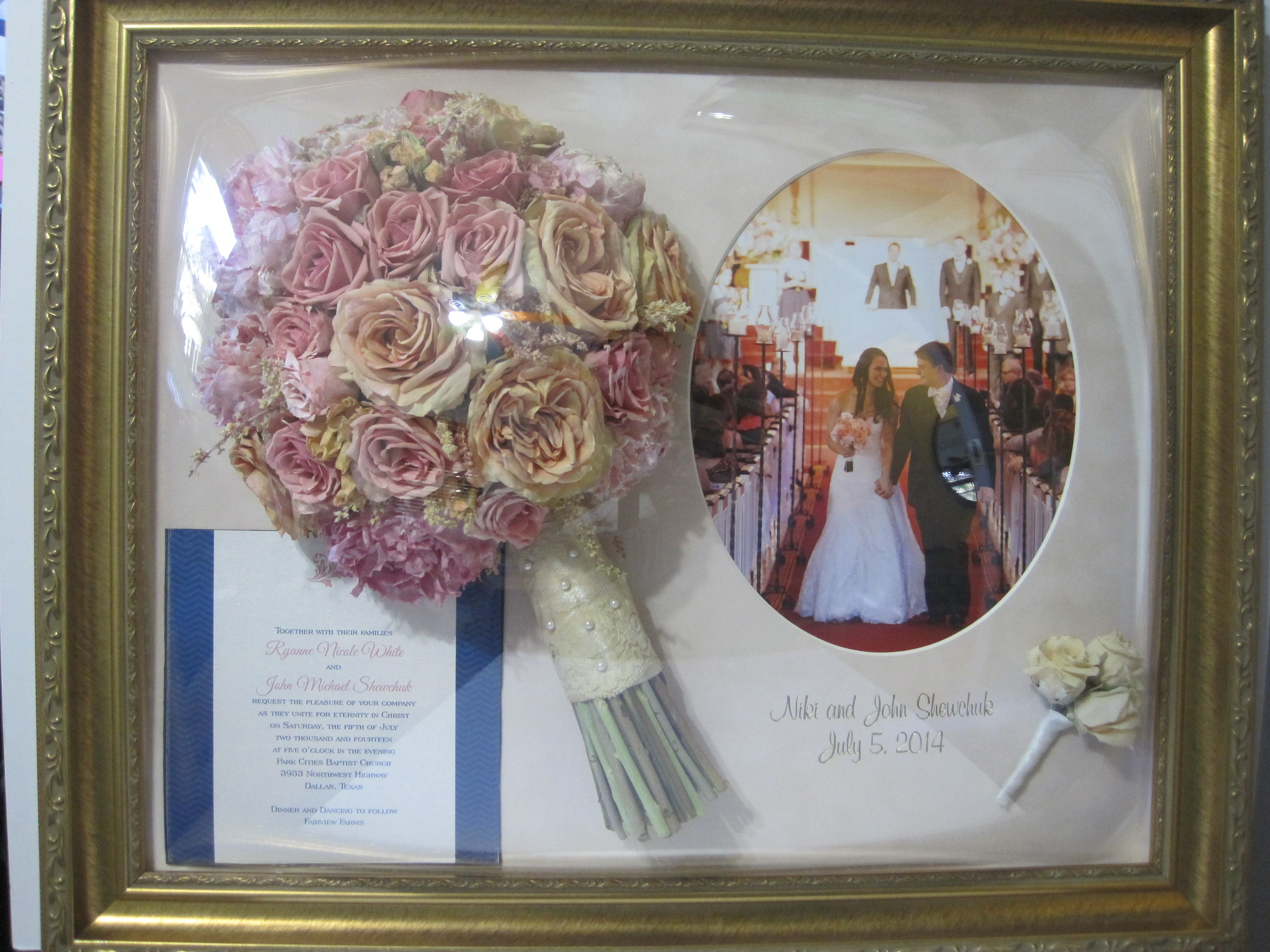 preserved wedding bouquet framed with invitation, 8x10 picture with oval opening, boutonniere, and engraving in an antique gold frame.