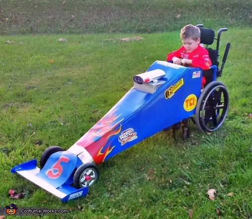 Decorate wheelchair to make a dragster for Halloween