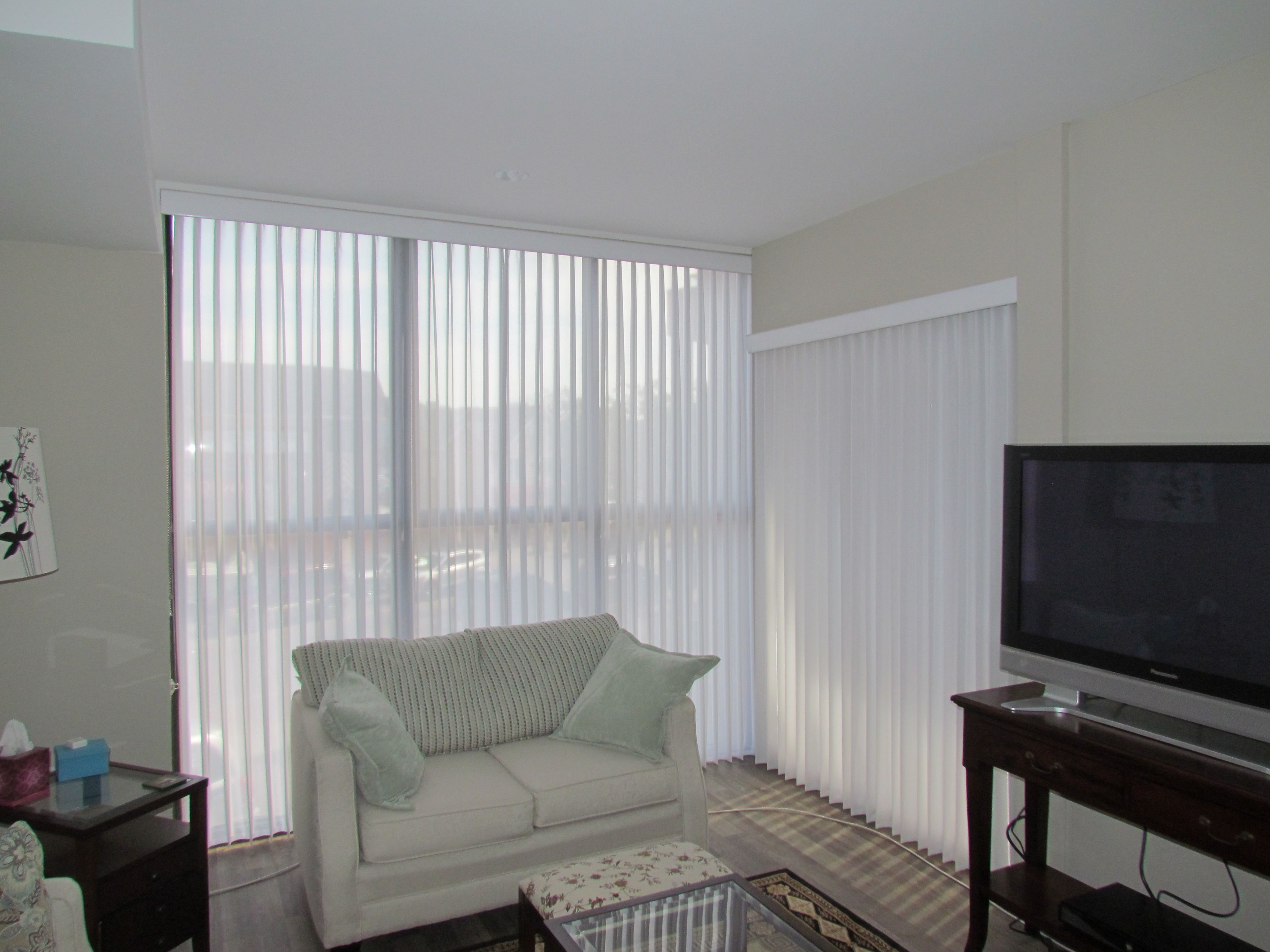 Vertical blinds with attached sheer. Easy to clean (remove