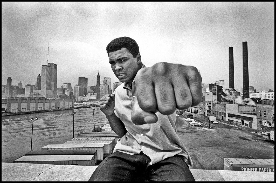 Muhammad Ali on a bridge overlooking the Chicago River and the city's skyline, 1966