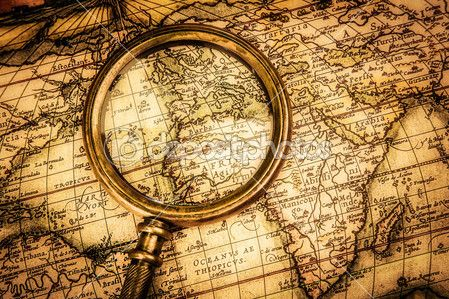 Vintage magnifying glass lies on an ancient world map foto de vintage magnifying glass lies on an ancient world map foto de stock gumiabroncs Image collections