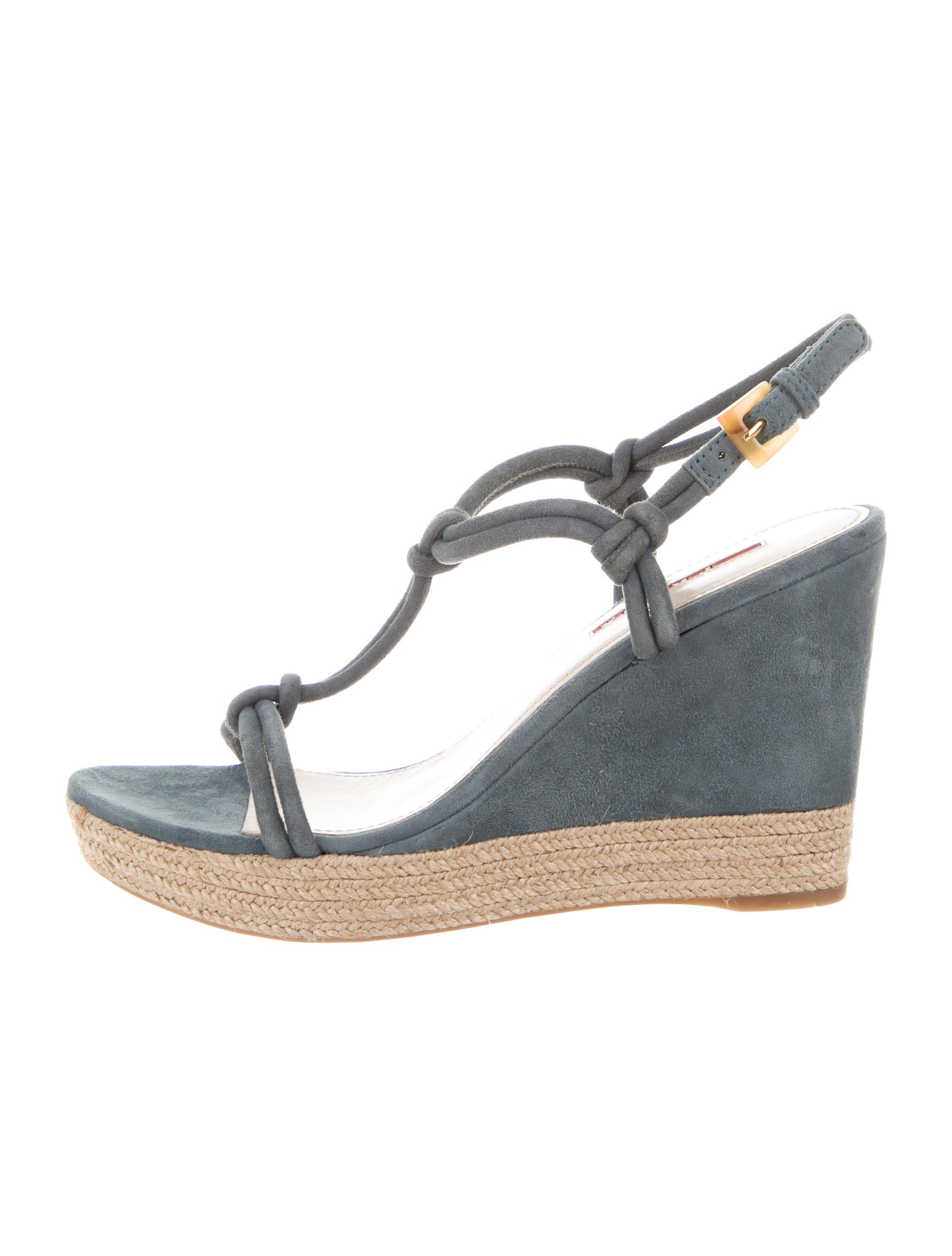 0ac45474b905 Blue suede Prada Sport round-toe wedge sandals featuring covered heels and  buckle closures at