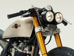 http://www.caferacerz.com/cafe-racer-headlight-options-for-your-project