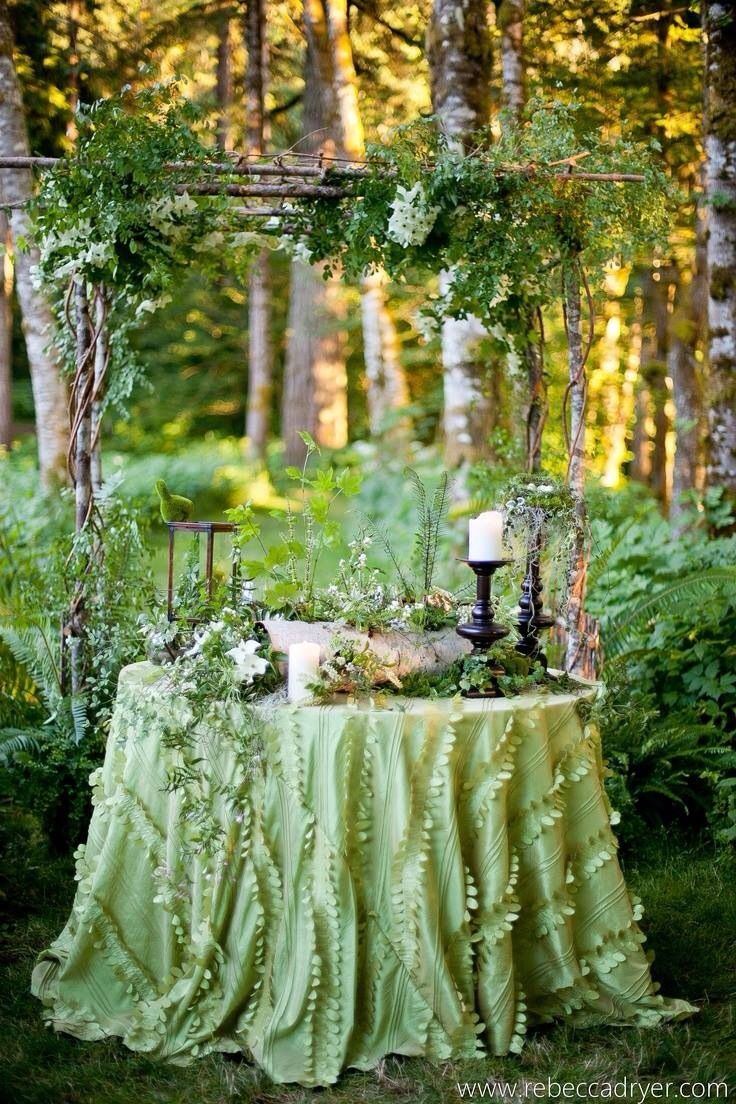 an elegant fairy tale tea party...Ana Rosa / Green tablecloth and green foliage makes a very elegant setting for two.