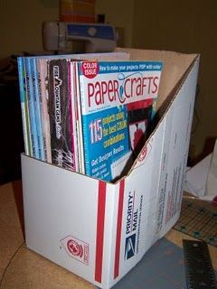 magazine file on the cheap - these boxes are free at the post office - I would cover it with cute paper/fabric though.