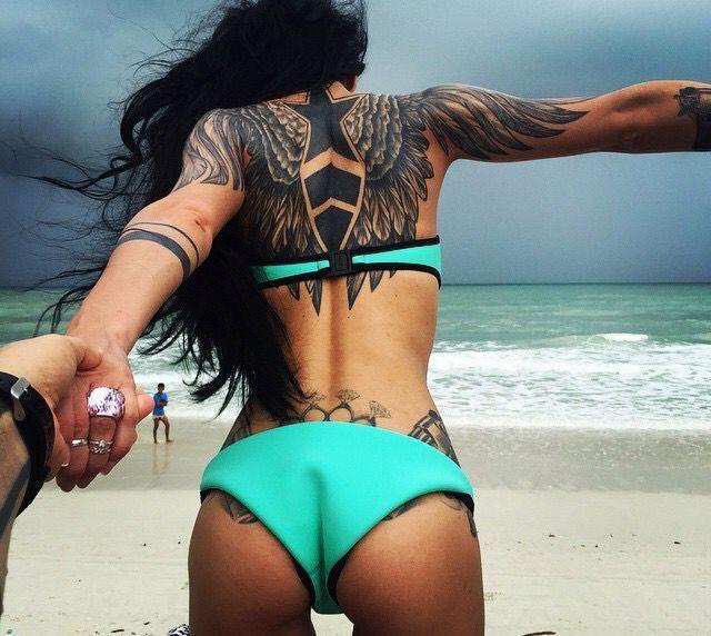 Imagini pentru tattooed girl beach