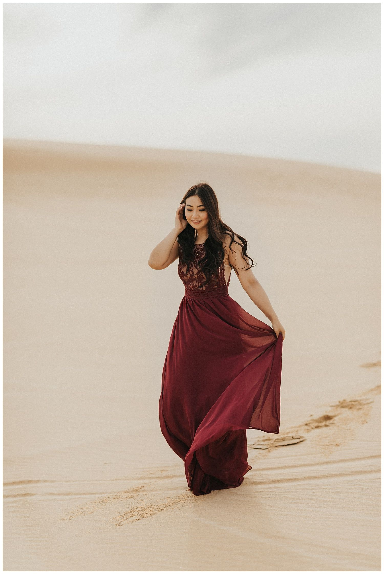 Maroon Maxi Dress For This Bride At Her Sand Dunes Pre Wedding Shoot Also A Beautiful Option For Bridesmaids Sand Dunes Photoshoot Pre Wedding Bride Style [ 2240 x 1500 Pixel ]