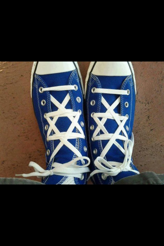 Tying The Shoe Laces On Chuck Taylors Into A Star Of David Pattern