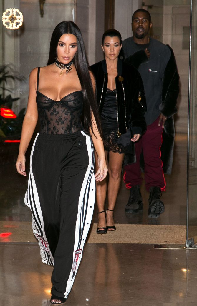 ade7df2480bed3 Kim Kardashian's Sexy Paris Fashion Week Outfits - sheer bustier and Adidas  pants