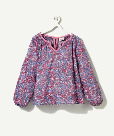 LA CHEMISE ANEMONE :                     On craque pour cette blouse au style romantique et raffiné pour un look très féminin             LA CHEMISE À FLEURS, col tunisien ouvert, manches longues élastiquées, goutte d'eau fermée par un bouton, motifs fleuris.