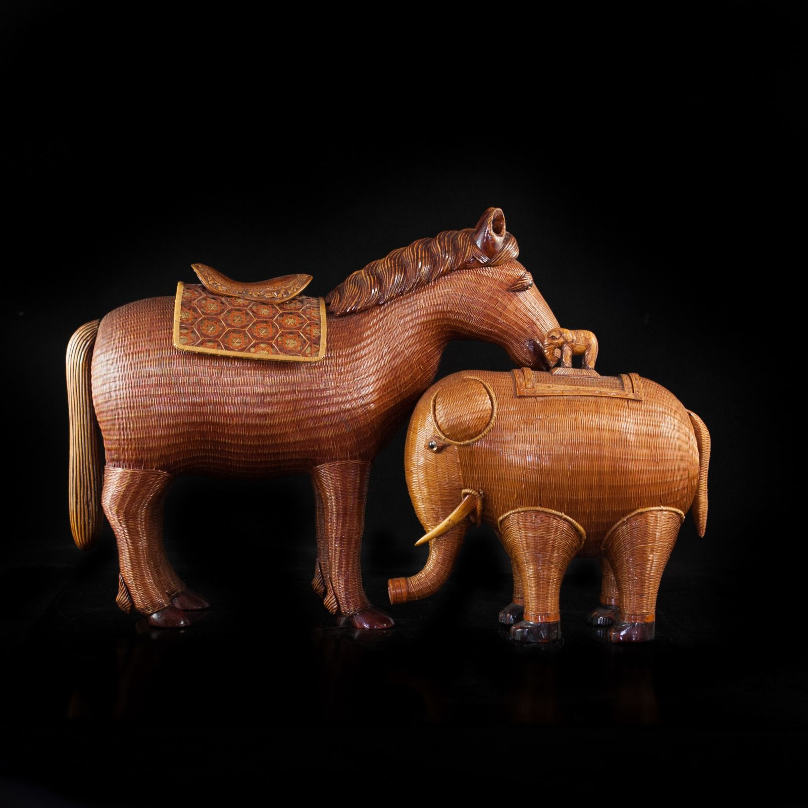 Lot #219: Chinese Wicker Figurines DESCRIPTION: Chinese hand made wicker figurines depicting an elephant and horse, each figurine opens revealing a ceramic interior box compartment.  CIRCA: 20th ORIGIN: China DIMENSIONS: Horse: H: 16″ L: 14″ Elephant: H: 10″ L: 10″