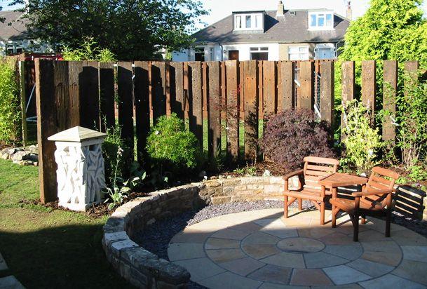 Railway sleeper fence home outdoor ideas pinterest for Garden designs using railway sleepers