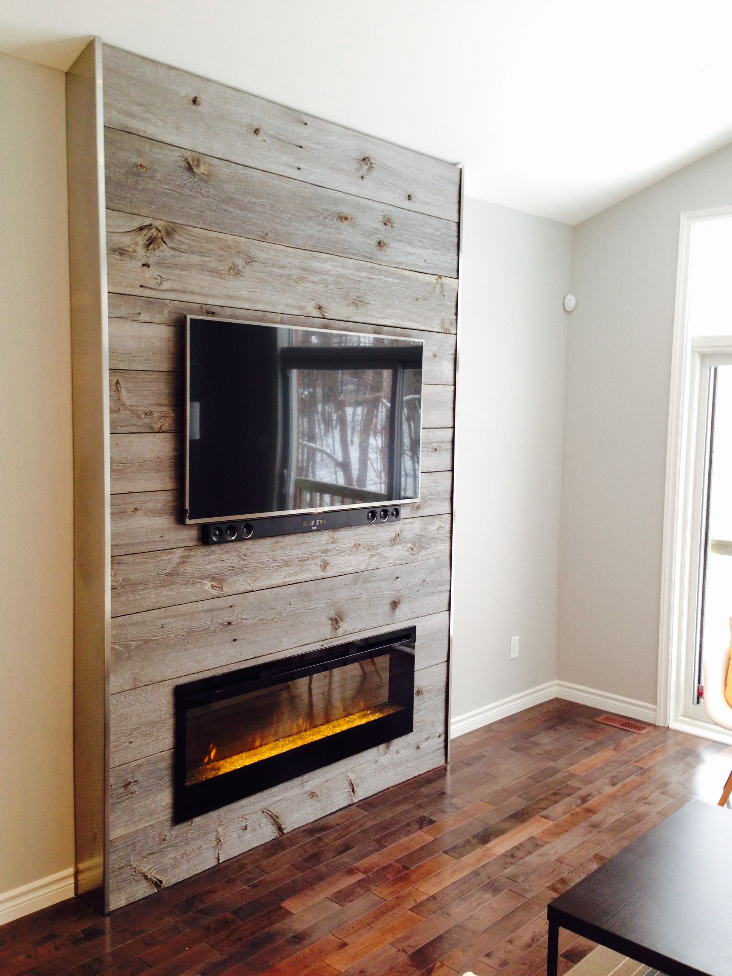 Fireplace feature wall completed with grey reclaimed barn
