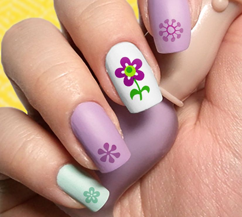"""Easter waterslide nail decals. What better way to prepare for the upcoming holidays than to add festivity to your nails. Easter Bunny, flowers, decorated eggs, and more! 5.5"""" x 3"""" sheet."""