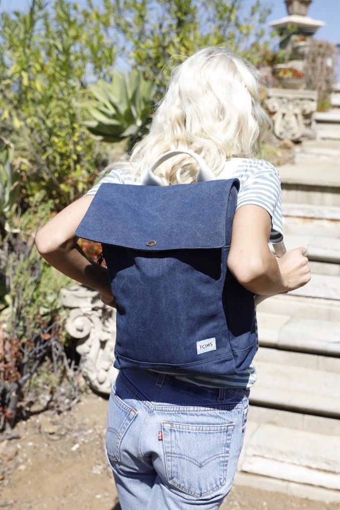 7677efe45e For the avid traveler, Navy Washed Canvas TOMS Trekker Backpack. It has  enough room for daily adventures and includes a 13 inch laptop pocket.