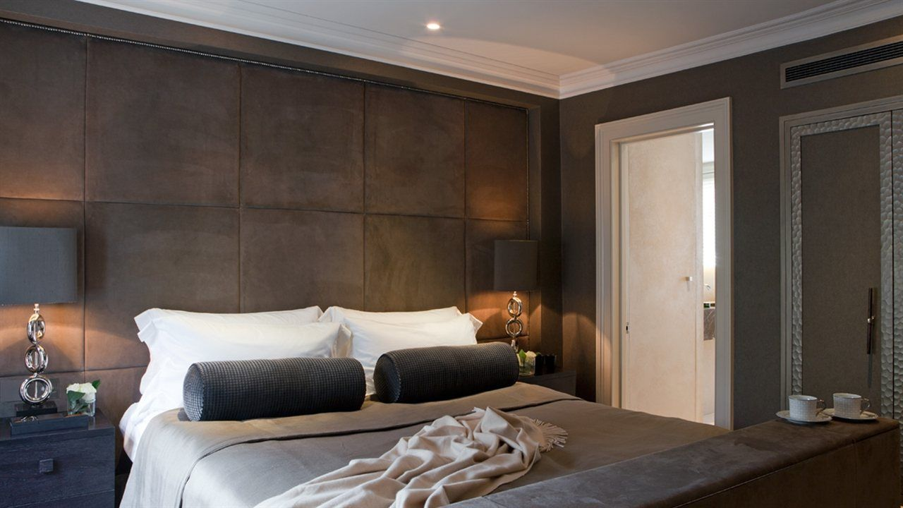 rich chocolate suede padded wall with cappuccino and charcoal palette - chic  hotel style bedroom -