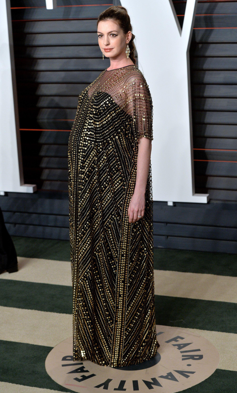 Anne Hathaway.. Naeem Khan Fall 2015 gown, Forevermark jewels, Salvatore Ferragamo heels, and Jimmy Choo clutch.. #stylethebump