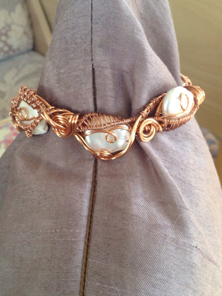 Coin shaped pearls woven in copper wire