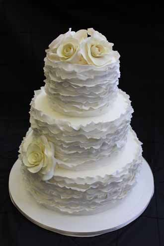 I like this...but you know it's not really so ruffled but more messy wavy in a way like they just didn't spread on the icing smoothly.