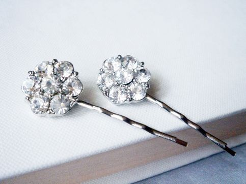 So pretty and delicate, a pair of silver tone bobby pins that is perfect for adding subtle sparkle to a stylish French pleat, chic high bun or simply to keep hair out of your eyes. These beautiful hair pins would also be perfect for brides who adore simple and elegant wedding hair accessories and...