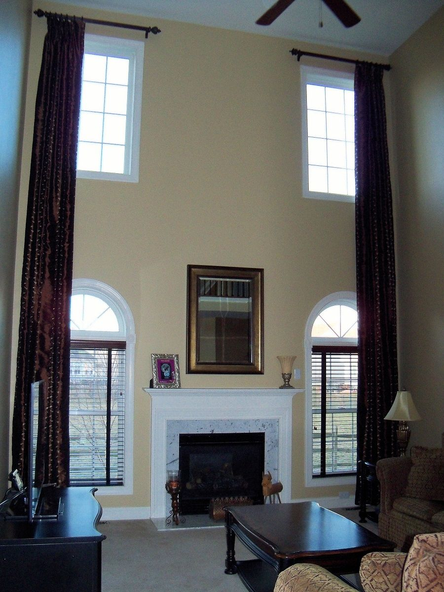 I sewed and installed these two story family room drapes in a faux silk fabric
