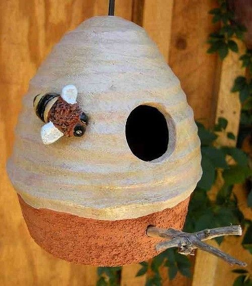 Whimsical birdhouse offers a fine nest site and roost for feathered friends! Handcrafted pottery that squirrels can't chew, features beaded cord for easy hanging, twig perch and ample drainage. Design