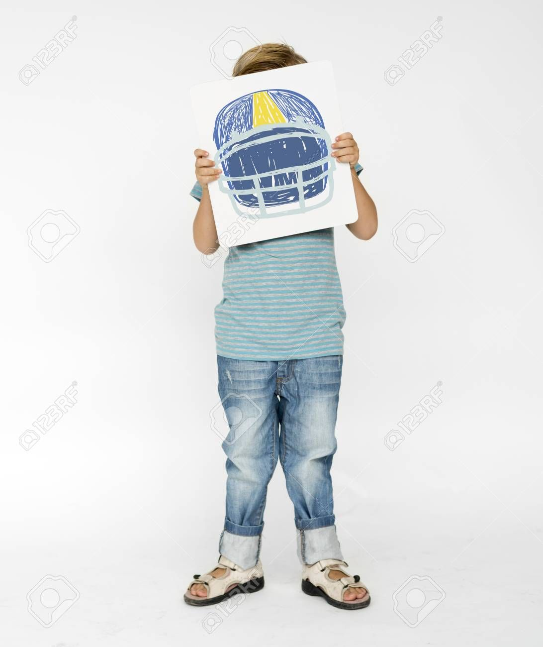 Children with a drawing of American football helmet Stock Photo