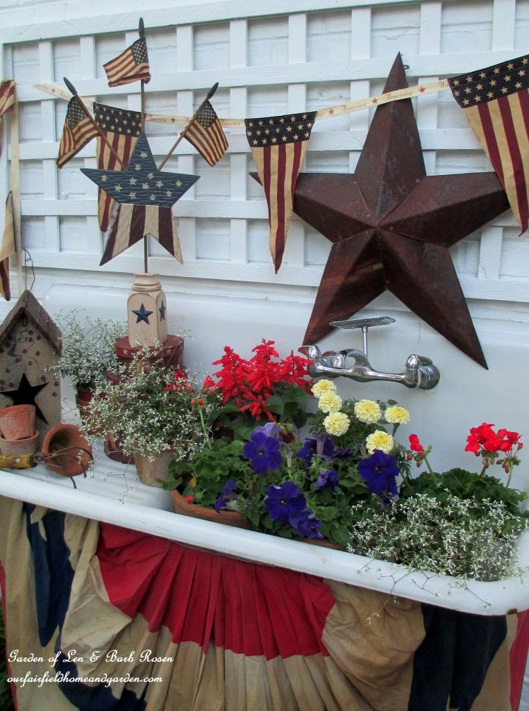 Red, white and blue flowers in the potting sink!