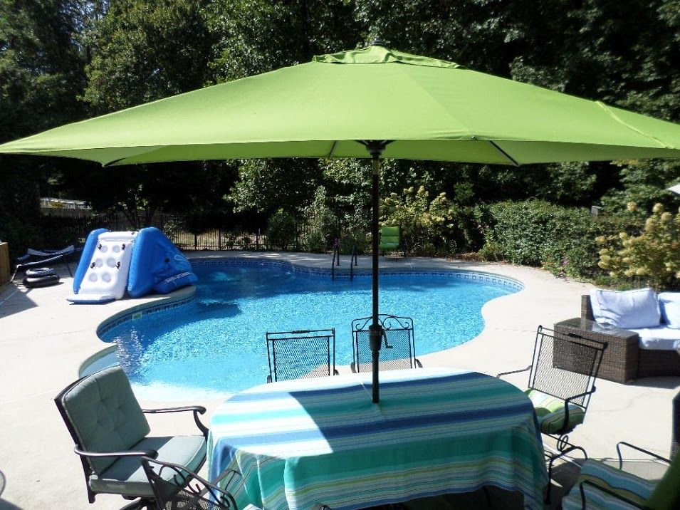 A Rectangular Patio Umbrella Provides Excellent Shade For An Oval Or Shaped Table