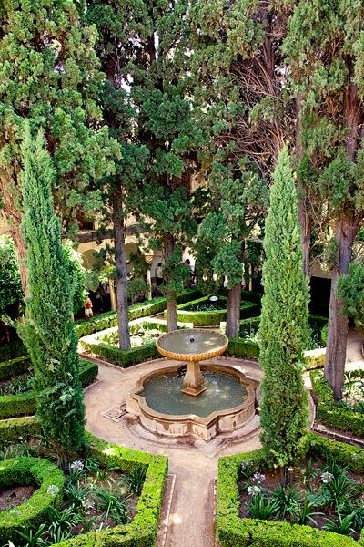 The formal and secluded courtyard gardens of the Moorish palace La Alhambra. Spain. Photo by Henri Lassande