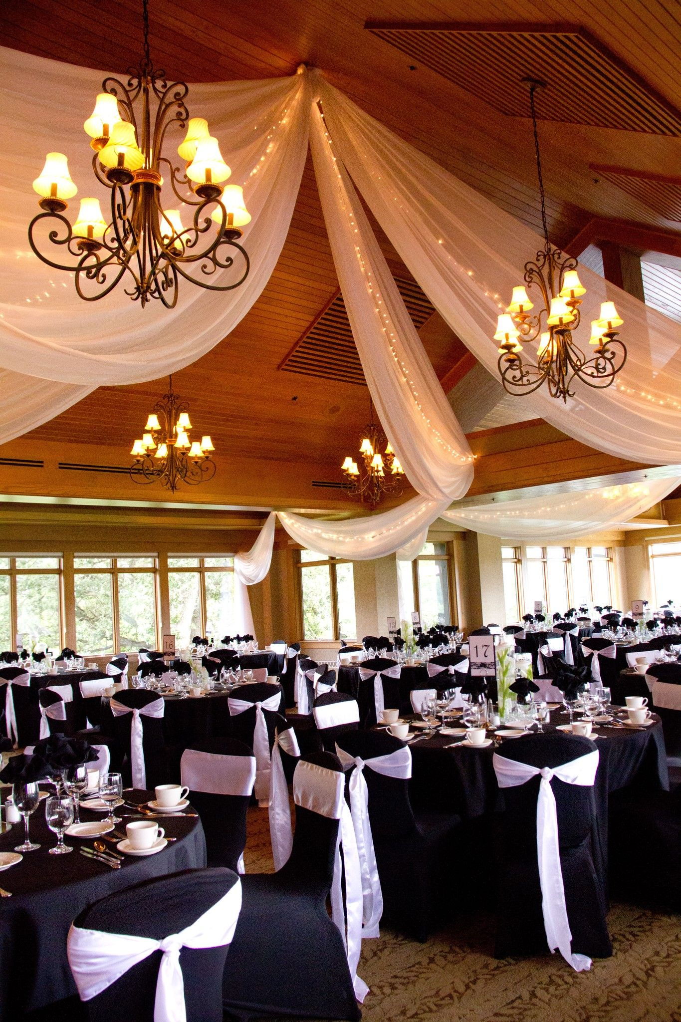 Black & white wedding reception using black chair covers ...