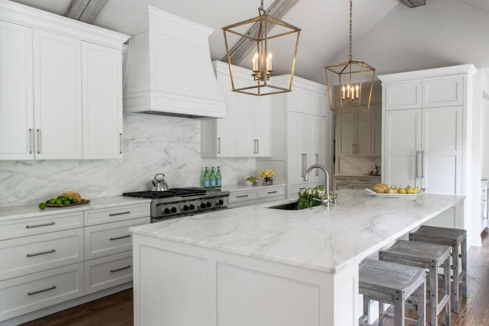with vaulted ceilings marble surfaces and crisp white cabinetry this contemporary kit on kitchen cabinets vaulted ceiling id=71241