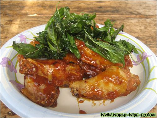 Spicy glaze garlic chicken wings with deep fried basil from opal food spicy glaze garlic chicken forumfinder Choice Image