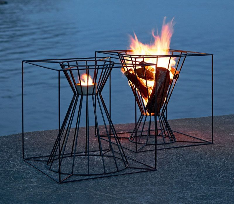 Warm Up Your Life With These 13 Freestanding Fireplace Designs // These steel fire baskets allow you to use eit