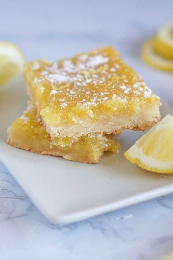 Easy lemon bars made with fresh lemons. The perfect lemon bar recipe that is easy and a tried and true recipe we make offer for a summer dessert.