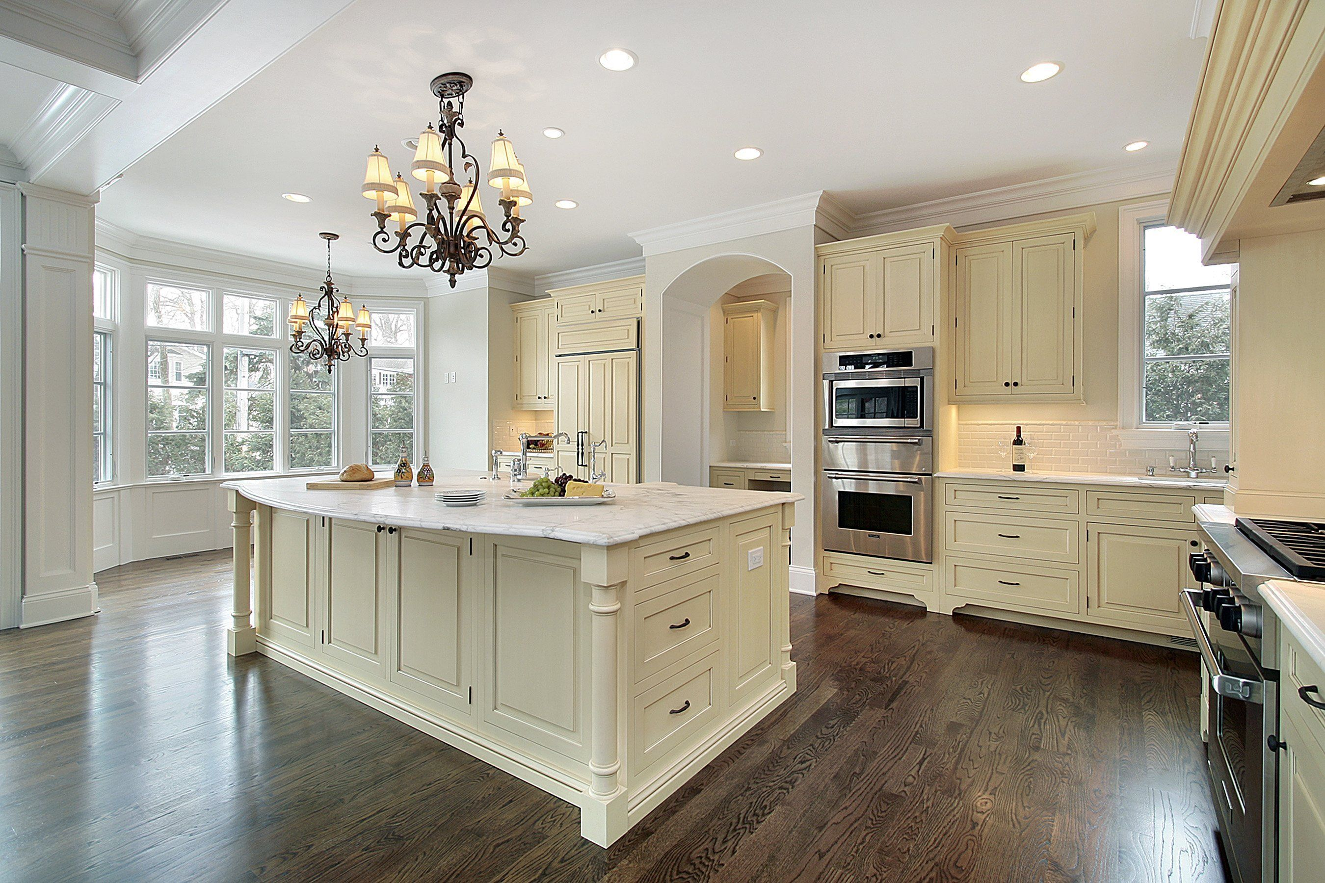 Classic Kitchen With Off White Cabinets White Tile Backsplash And Marble Counte Antique White Kitchen Antique White Kitchen Cabinets Off White Kitchen Cabinets