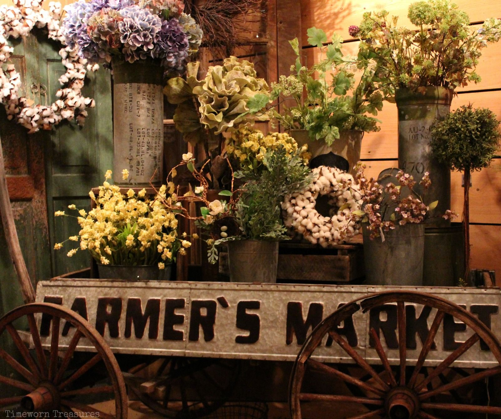 Rustic antique wagon Farmer\'s Market display full of flowers spring ...