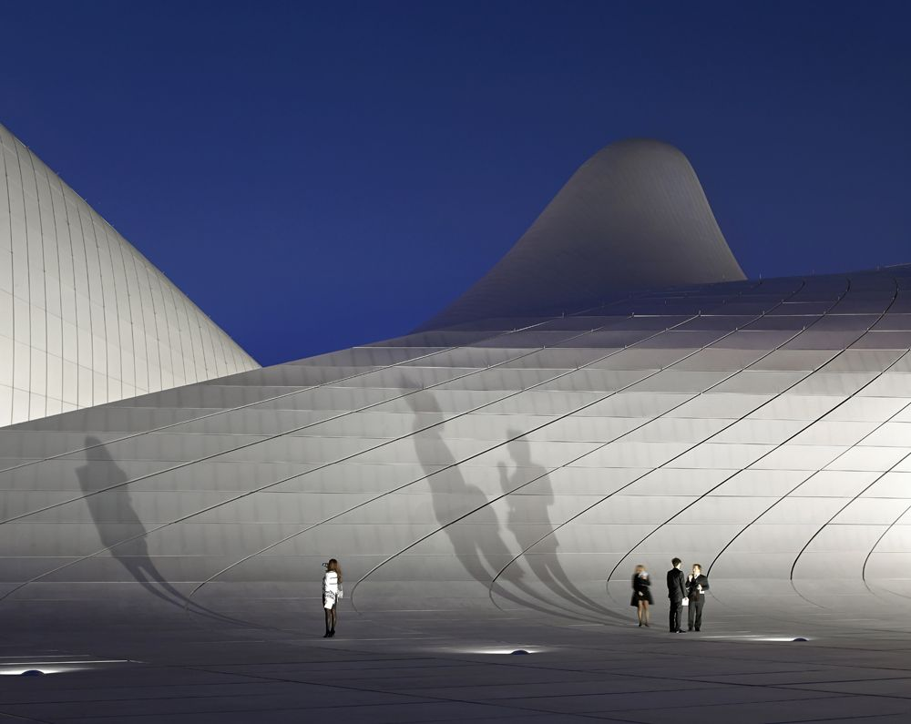 14 of the Best Architecture Photos From the Past Year | An exterior shot of Hadid's Heydar Aliyev Center captured just after dusk | Credit: Hufton and Crow | From Wired.com