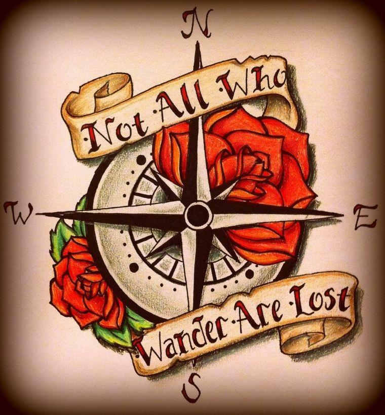 tatuaggi old school, una grande bussola con delle scritte e due rose rosse