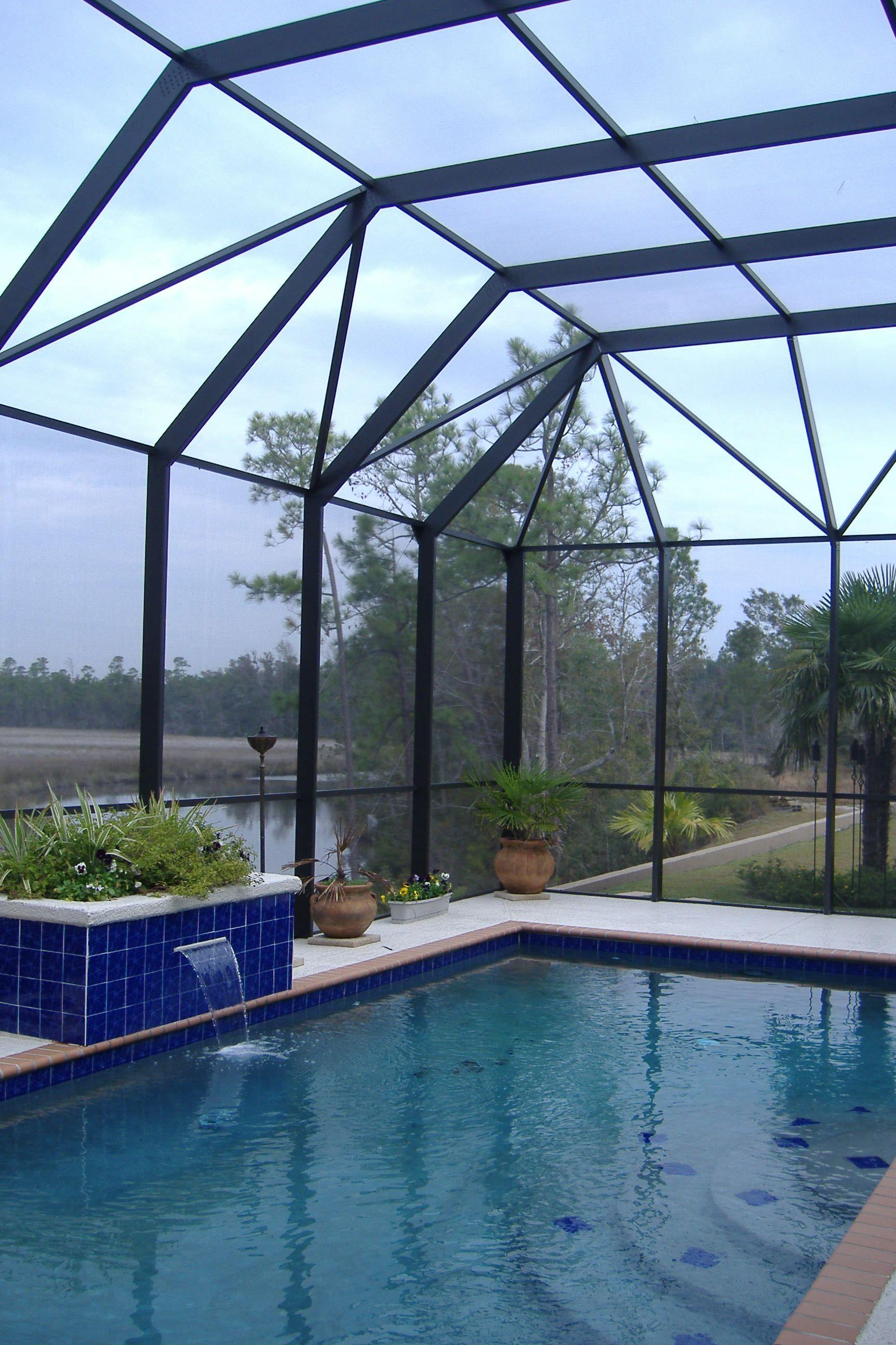 Bronze Frame Mansard Style Roof Overlooks The Bayou In Gautier,
