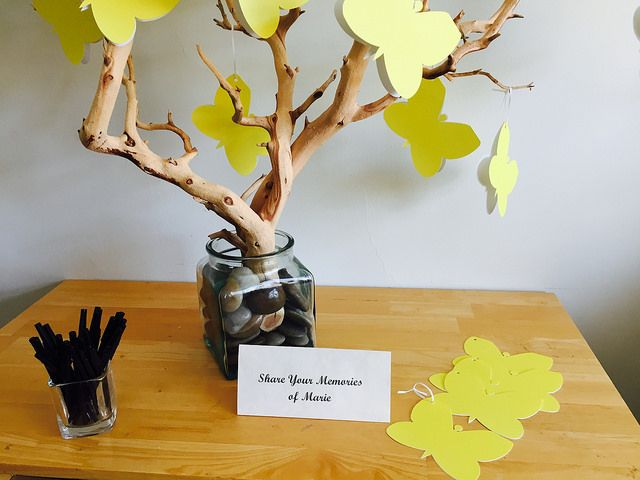 These yellow butterfly cards are a great way to share memories and stories of a loved one. Add them to a tree to create a beautiful display of a lifetime of memories. #funeralgift #funeralidea #giftsforafuneral #butterflycardforfuneral #lifecelebrationidea #diyfuneralidea