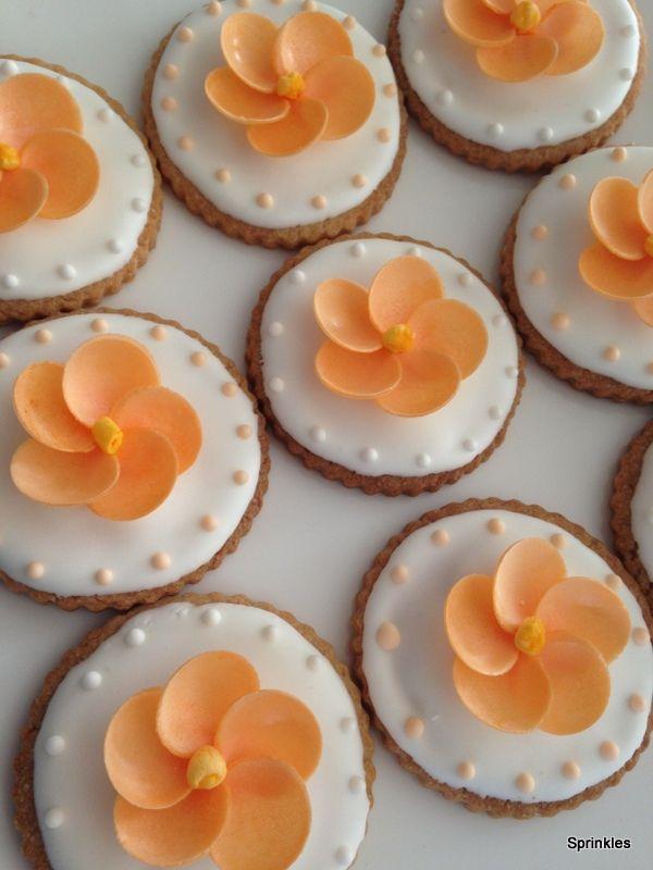 Orange flower cookies with royal icing