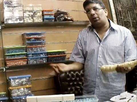 He keeps illegal ivory in the back of his store- bad man