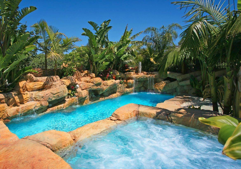 A Pool That Looks And Feels Like A Tropical Paradise Backyard Pool Tropical Backyard Pool Landscaping Backyard Pool Pool Landscaping