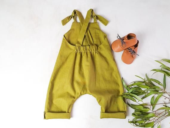 The green linen overalls with tie front straps are a beautiful classic piece for your little ones wardrobe. I cut and sew each of these rompers from a beautiful linen cotton blend fabric which is easy to care for and softens more with each wash. Your child will find these dungarees so comfortable