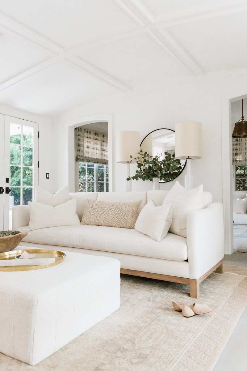 This space represents harmony because of all the white furniture with the white walls and floor. The rounded lamps, plate on the table and mirror also make for harmony as well.